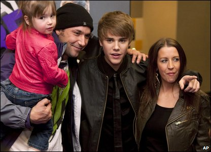 Justin Bieber with his family before the screening of his new film, Never Say Never.