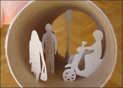 Road scene made inside a toilet roll.