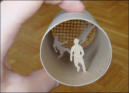 Football scene made inside a toilet roll.