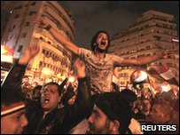 Protesters celebrate the news of Mubarak's resignation