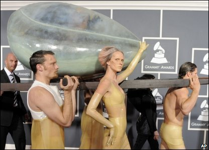 Lady Gaga being carried down the red carpet at the Grammy Awards, in a giant egg!