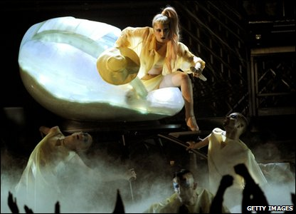 Lady Gaga breaking out of her shell onstage at the Grammy Awards