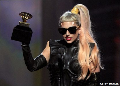 Lady Gaga picking up one of the three Grammy Awards she won on the night