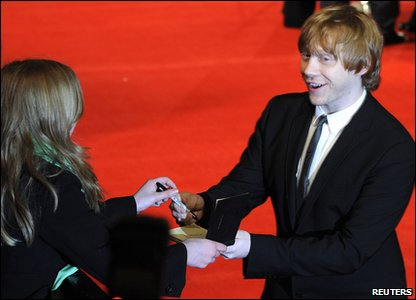 Rupert Grint a.k.a. Ron Weasley from Harry Potter signs autographs at the Bafta ceremony.