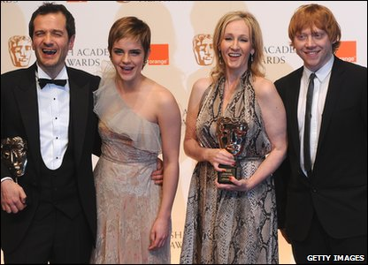 Harry Potter producer David Heyman, actress Emma Watson a.k.a. Hermione Granger, author J.K. Rowling and actor Rupert Grinch a.k.a. Ron Weasley smile for the cameras on the Bafta red carpet