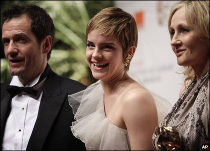 Harry Potter producer David Heyman, actress Emma Watson a.k.a. Hermione Granger and Harry Potter author J.K. Rowling smile for the cameras on the Bafta red carpet.