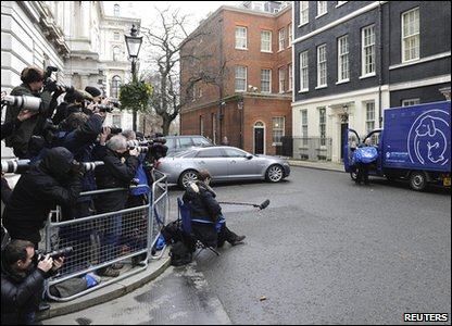 Photographers wait at Downing Street for Larry the cat