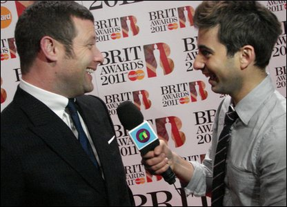Brits: X Factor host Dermot O'Leary laughs with Ricky at the Brit Awards 2011