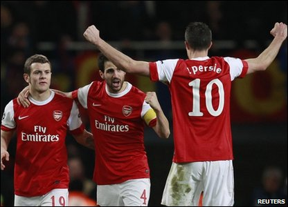Arsenal celebrate beating Barcelona