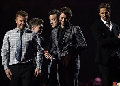 Brits: Take That collecting their prize at the Brit Awards 2011