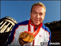 Sir Chris Hoy with the three gold medals he won at the Beijing Olympics in 2008