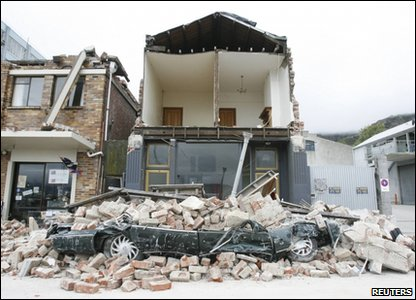 A car that's been crushed by debris after an earthquake in Christchurch, New Zealand