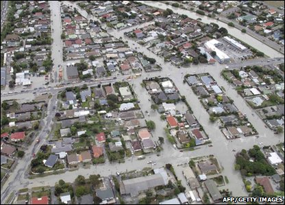 Flooding in a suburb of Christchurch, New Zealand, after a powerful earthquake hit south of the city