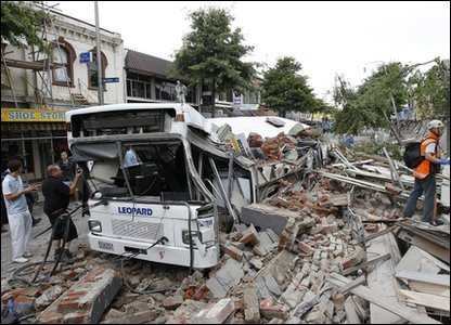 A bus covered in rubble after a powerful earthquake hit Christchurch in new Zealand
