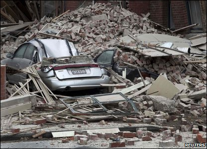 Cars are crushed by fallen concrete after an earthquake in central Christchurch