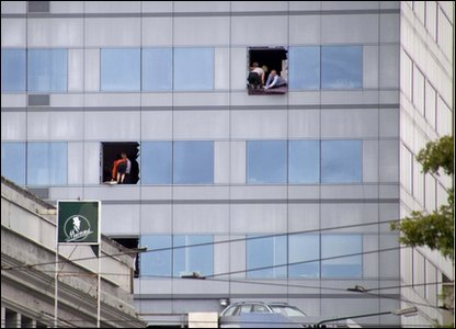 People in a high rise building in Christchurch New Zealand await rescue