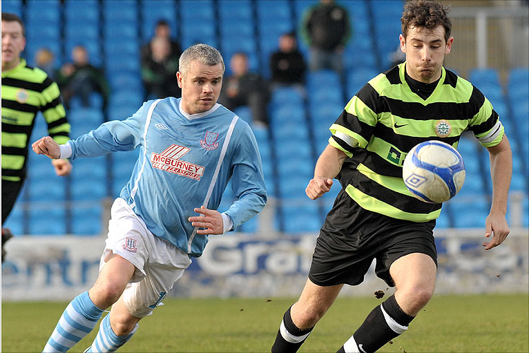 Gary mccutcheon of ballymena united battles for the ball with donegal