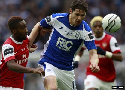 Arsenal's Johan Djourou (Left) challenges Birmingham City's Nikola Zigic (Centre) during the Carling Cup final at Wembley Stadium in London