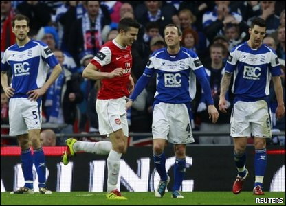Arsenal's Robin Van Persie (3rd Left) runs past dejected Birmingham City players after scoring during the Carling Cup final at Wembley Stadium in London