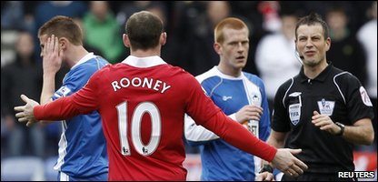 Wayne Rooney also got a telling off after elbowing a Wigan player in the head