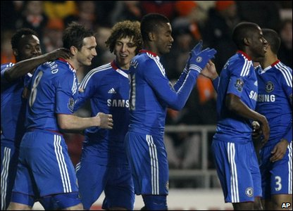 Chelsea players celebrate after a goal