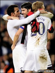 (L-R) Sandro, Vedran Corluka and Michael Dawson of Tottenham Hotspur celebrate at the end of their UEFA Champions League second leg match against AC Milan at White Hart Lane