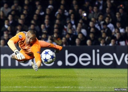 Tottenham Hotspur goalkeeper Heurelho Gomes dives to make a save during the UEFA Champions League second leg match at White Hart Lane.