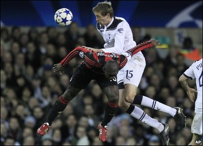 Tottenham Hotspur's Peter Crouch, right, competes with AC Milan's Clarence Seedorf during their Champions League second leg match at White Hart Lane