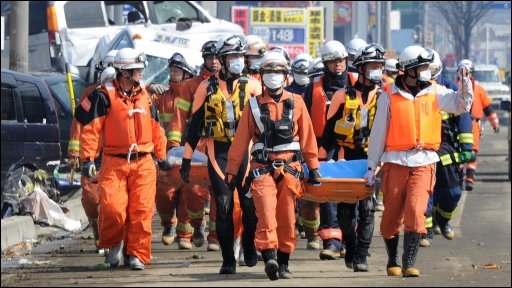 Emergency teams head towards rescue operations at the port area of Tagajo, Miyagi Prefecture, after the massive earthquake and tsunami destruction in Japan