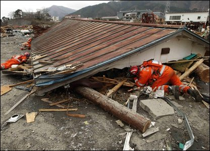 Rescue workers search for survivors in Japan