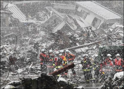Snow is falling in Japan, making the search for survivors of the earthquake and tsunami really difficult for rescue teams.