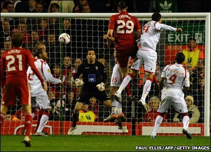 Liverpool's Andy Carroll goes close to scoring