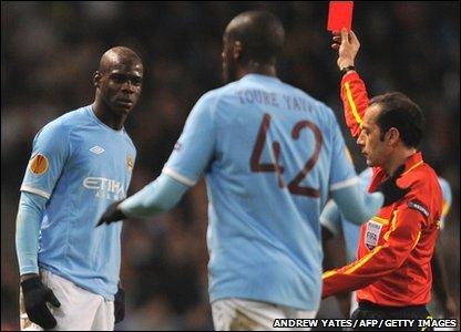 Mario Balotelli is shown a red