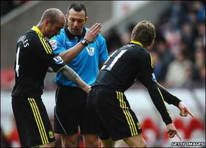 Referee Kevin Friend is put under pressure by Miereles