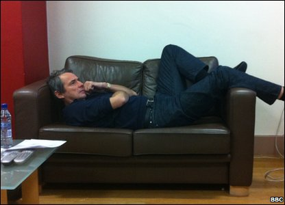 MOTD's Alan Hansen lying on a sofa