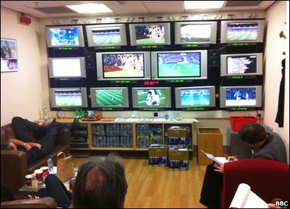 MOTD team watching football on television screens