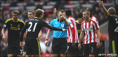 Referee Kevin Friend is put under pressure by Liverpool players