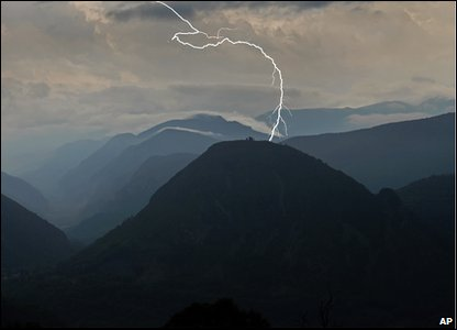 Lightening strikes a mountain