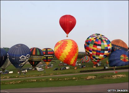 Balloons line up for take-off
