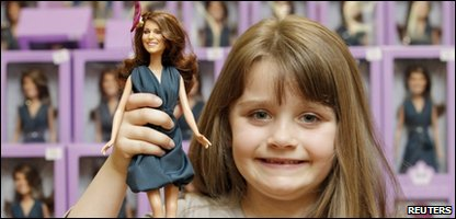 Five-year-old Jessica clutches the mini princess