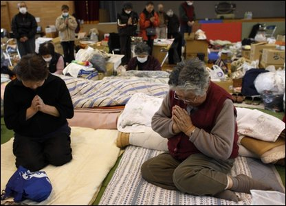 Victims of the March 11 earthquake and tsunami observe a minute of silence at a shelter in Kamaishi, Iwate prefecture