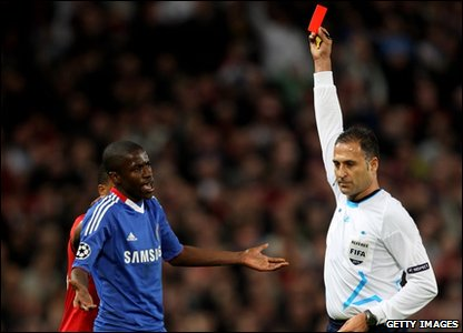 Ramires is shown a red card by the referee.