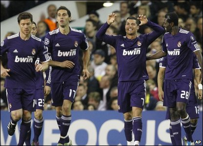 Cristiano Ronaldo reacts to scoring a goal at the Champions League quarter-finals at White Hart Lane
