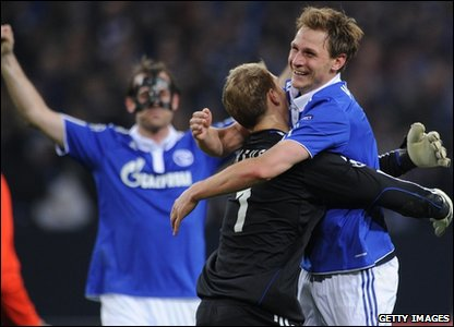 Schalke's players, defender Christoph Metzelder, goalkeeper Manuel Neuer and defender Benedikt Hoewedes celebrate after the UEFA Champions League quarter final