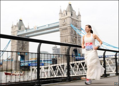 A woman who is hoping to breaking the record for running a marathon in a wedding dress