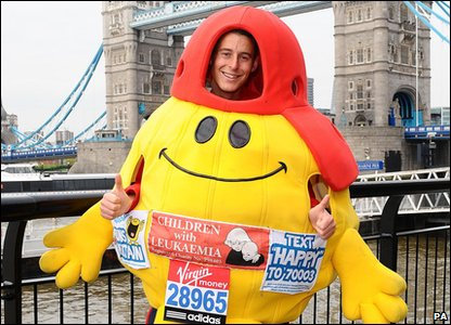 A man trying to run the fastest marathon dressed as a book character