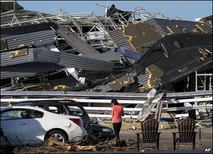 Tornadoes rip through America - survivor stands out crushed hardware store in North Carolina