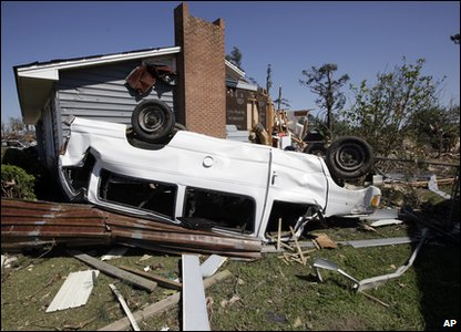 Tornadoes rip through America - overturned van in North Carolina