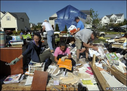 Tornadoes rip through America - people sort through remains of their belongings in North Carolina