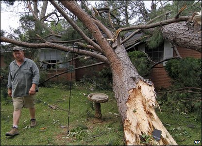 Tornadoes rip through America - fallen tree crushes home in Mississippi
